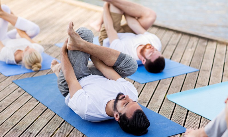 men in yoga pose - hamayareeveyoga.com